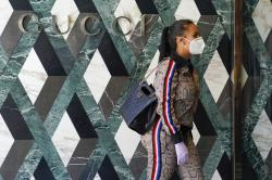 Delicia Cordon waits to pick up a purchase at Gucci on Rodeo Drive.