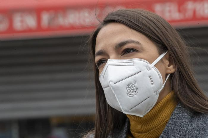 In this Tuesday, April 14, 2020 file photo, Rep. Alexandria Ocasio-Cortez, D-N.Y., wears a face mask during a news conference to call on FEMA to grant approval for Disaster Funeral Assistance to help families in lower-income communities and communities of color across New York amid the COVID-19 coronavirus pandemic, in the Corona neighborhood of the Queens borough of New York