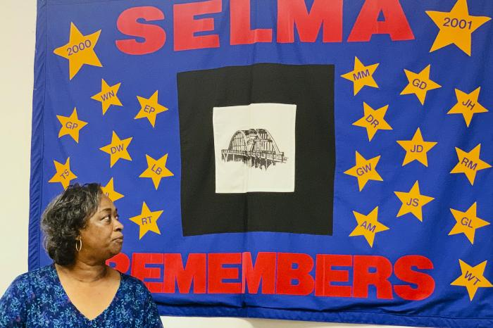 Mel Prince, executive director of Selma AIR, looks at a quilt that remembers people who lost their lives to AIDS, at her office in Selma, Ala.