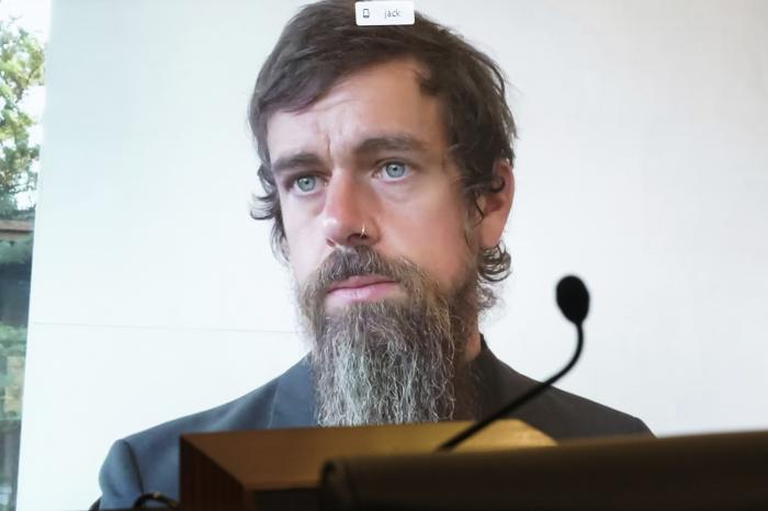 Twitter CEO Jack Dorsey appears on a screen as he speaks remotely during a hearing before the Senate Commerce Committee on Capitol Hill.