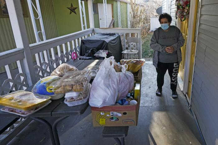 Evelyn Maysonet looks at the food delivery from the Weber-Morgan Health Department Tuesday, Nov. 24, 2020, in Ogden, Utah.