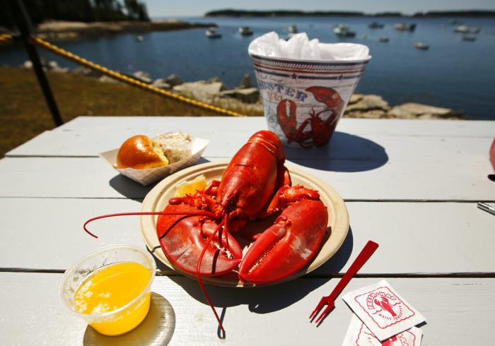 A lobster is served waterfront at McLoon's Lobster Shack in Spruce Head, Maine.