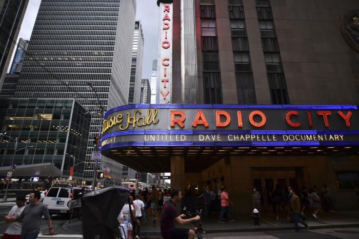 Radio City Music Hall's marquee advertises Dave Chappelle's untitled documentary during the closing night celebration for the 20th Tribeca Festival on Saturday, June 19, 2021, in New York