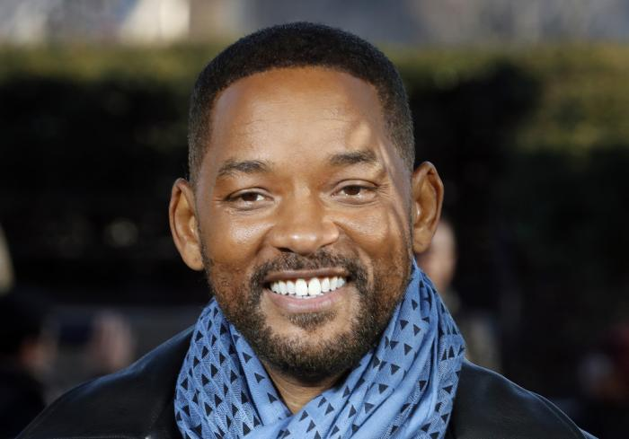 """In this Monday, Jan. 6, 2020, file photo, U.S actor Will Smith poses for photographers during the photo call of """"Bad Boys for Life,"""" in Paris"""