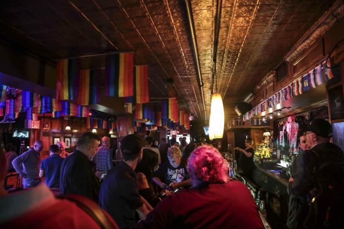 Customers gather at the Stonewall Inn in New York.
