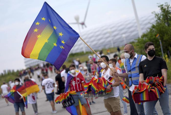 Football supporters are seen with LGBT pride flags outside of the stadium before the Euro 2020 soccer championship group F match between Germany and Hungary at the Allianz Arena in Munich.