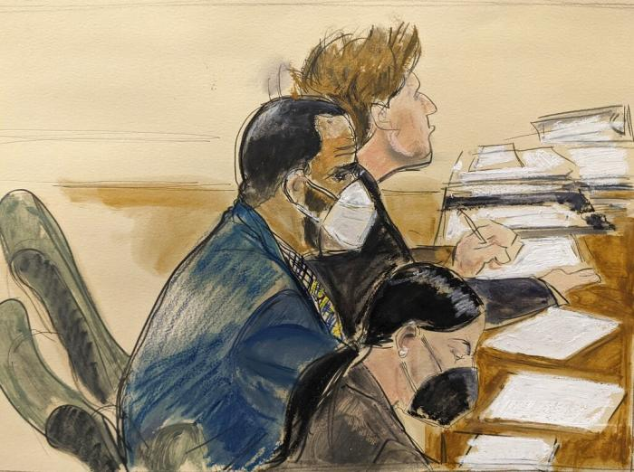 In this courtroom artist's sketch R. Kelly, left, listens during his trial in New York, Thursday, Aug. 26, 2021.